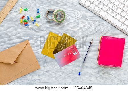 college entrance set with notebook, keyboard and pen on white desk background top view