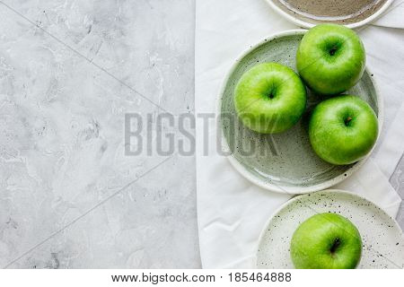 summer food with green apples on stone table background top view mock up