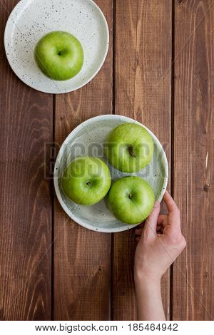 fresh organic green fruits with apples on wooden desk background top view
