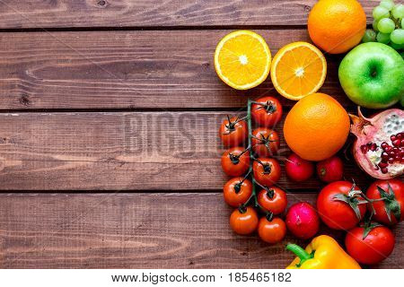 fresh vegetables and fruits for fitness dinner on wooden desk background top view mockup