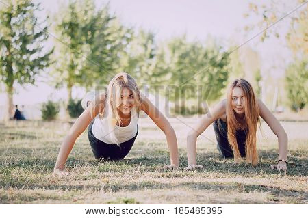 girls involved in sports and fitness in park