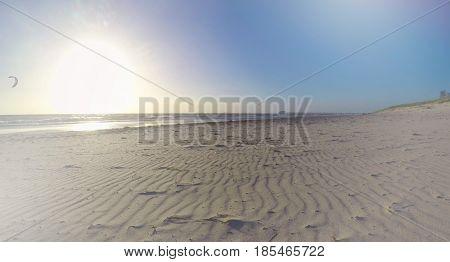 Sun Setting Low On Beach Scene