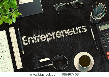 Entrepreneurs. Business Concept Handwritten on Black Chalkboard. Top View Composition with Chalkboard and Office Supplies. 3d Rendering. Toned Image.