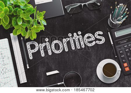 Priorities - Text on Black Chalkboard.3d Rendering. Toned Illustration.