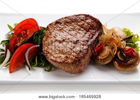 Grilled beefsteak on white background