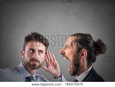 Man shouting to another man listening. Business announcement concept