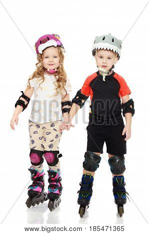 Little boy and girl skating in helmets and knee pads.Isolated on white background.