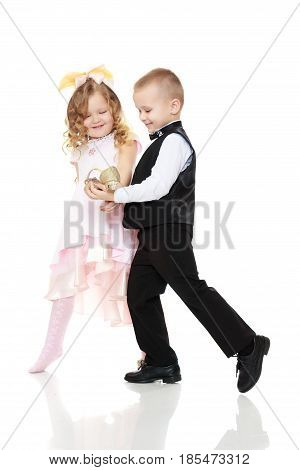 The little boy keeps at arm's length in front of her slipper.Isolated on white background.
