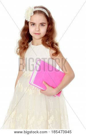 A nice little school-age girl in a smart white dress.He holds the book in his hand.
