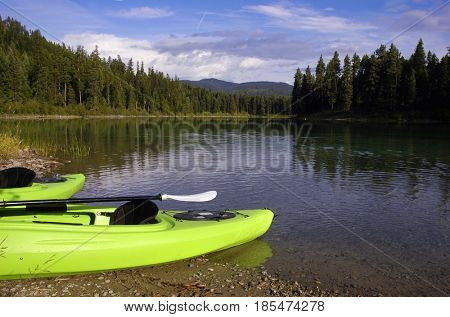 Pair of kayaks docked on the shore of a lake in Montana