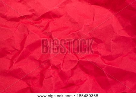 close up Red color crumpled paper texture background.