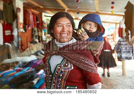 Peruvian Woman Have Fun With Kid