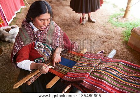 Peruvian Woman Making Traditional Wool