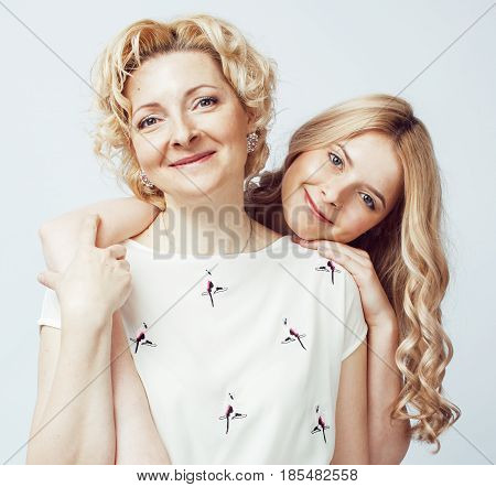 mother with daughter together posing happy smiling isolated on white background with copyspace, lifestyle people concept close up