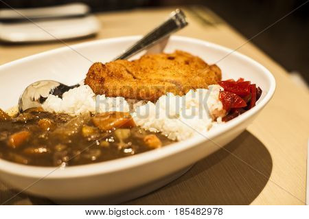Tonkatsu pork with rice and curry at a restaurant