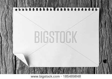 note paper on wood texture background with copy space. A blank notebook page on table wood office notebook Top view for design and background. notebook on wood. notebook on table. white notebook. notebook on woden.