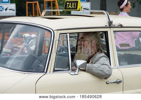 Berlin - May 11: An Old Taxi Driver, 26Th Oldtimer-tage Berlin-brandenburg, May 11, 2013 Berlin, Ger
