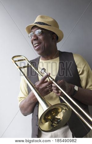 African American musician holding trombone