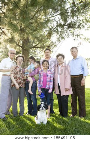 Chinese multi-generation family standing together outdoors