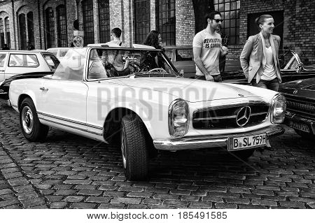 BERLIN - MAY 11: A sports car a two-door coupe Mercedes-Benz W113 230SL Automatic (black and white) 26th Oldtimer-Tage Berlin-Brandenburg May 11 2013 Berlin Germany