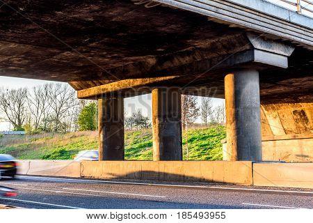 Empty UK Motorway under junction bridge evening.