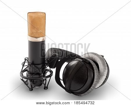 Headphones and condenser microphone isolated on the white background.