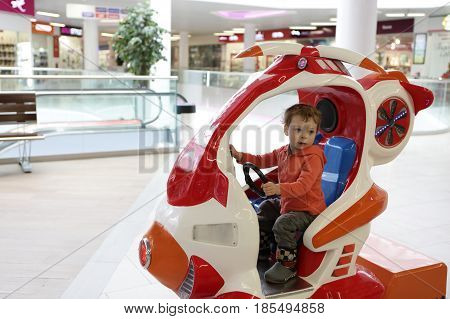Child In Toy Helicopter