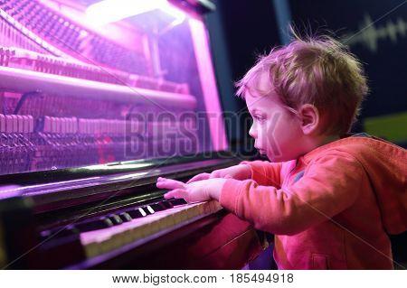Kid Playing On Light Music Piano