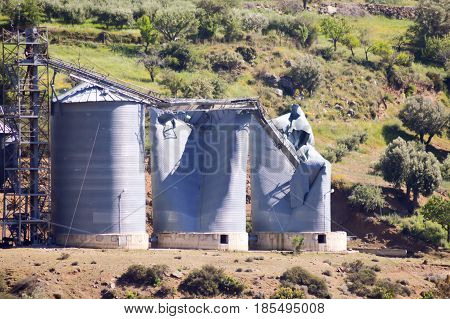 Grain silos blowing on a small hill in the center of Crete