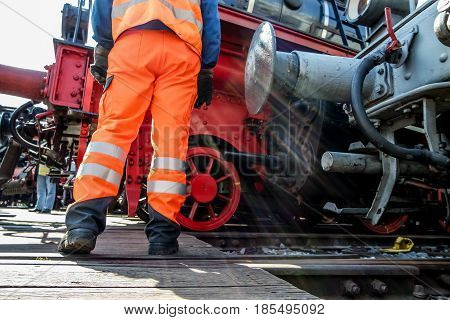 Railway worker in action at railway station