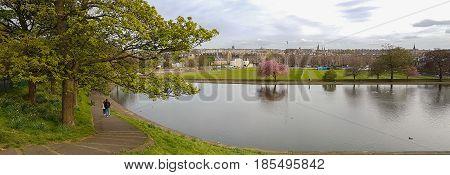 Panoramic Romantic View, Walking Couple At Inverleith Park, Edinburgh, Scotland