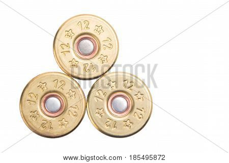 the concept of the three bullets of the 12th caliber for hunting rifles isolated on a white background