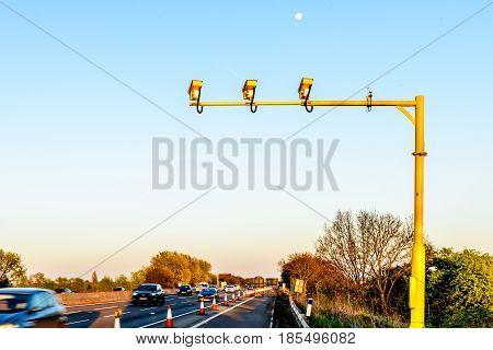Average Speed Camera on UK Motorway Evening.