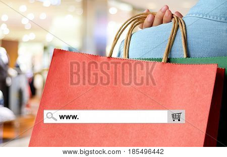 Word www. on search bar over red shopping bag and blur store background online shopping background business E-commerce web banner