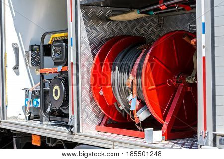 Hoses And Other Fire Fighting Equipment On Board A Fire Truck