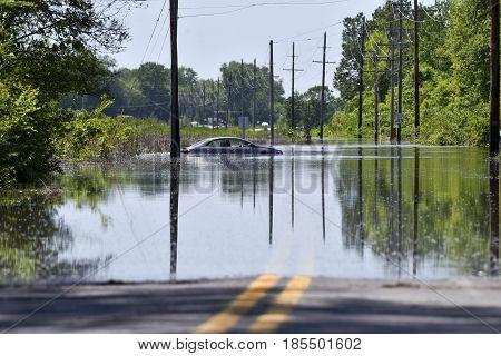 Staleld car stranded on a flooded road
