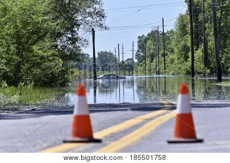 Stranded Car On A Flooded Road