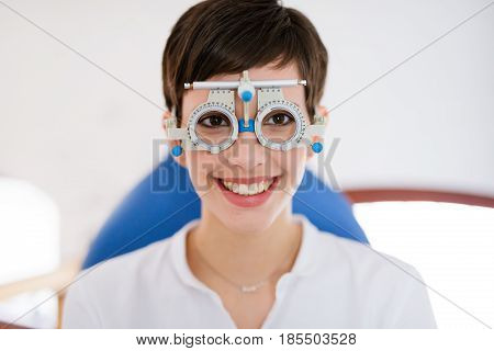 Beautiful woman doing eye test with optometrist in medical center