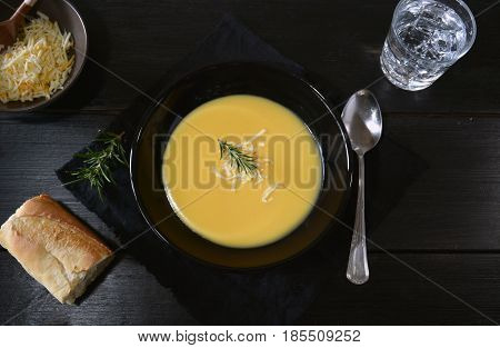 Vegetable Soup In Black Plate And Table Of Dark Wood