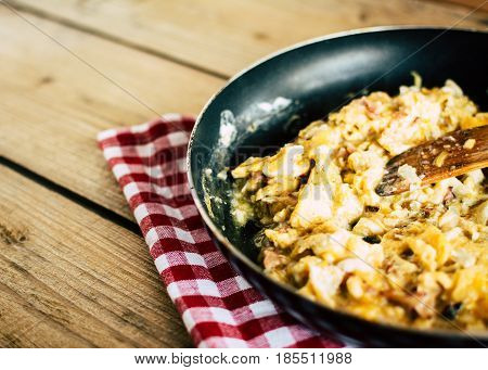 Scrambled Eggs on wooden background. healthy food