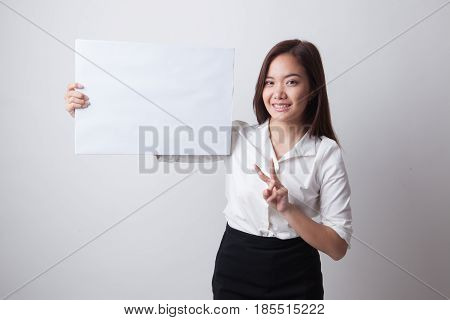 Young Asian Business Woman Show Victory Sign With Blank Sign.