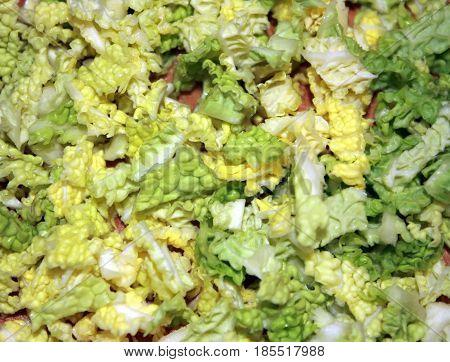 Background of chopped Peking cabbage. Peking cabbage salad