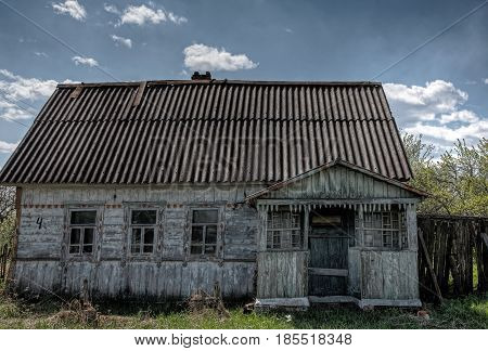 Abandoned house in the village with porch