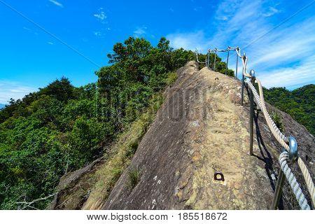 Rope hand rails following a hiking path along a trecherous mountain ridge on the Wu Liao Jian trail in Taiwan