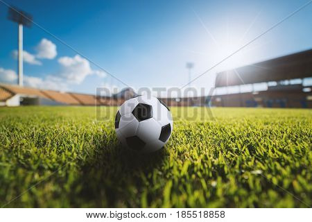 Soccer ball on the grass in soccer stadium. soccer ball concept background. Soccer bal on grass. Soccer bal on field. Soccer bal in stadium. Soccer bal sport.