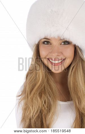 Attractive girl wearing white fur hat looking up and left isolated on white