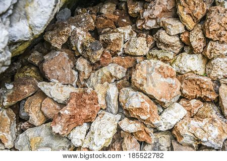 Pile of red and whte stones in a forest Polish jurrasic.