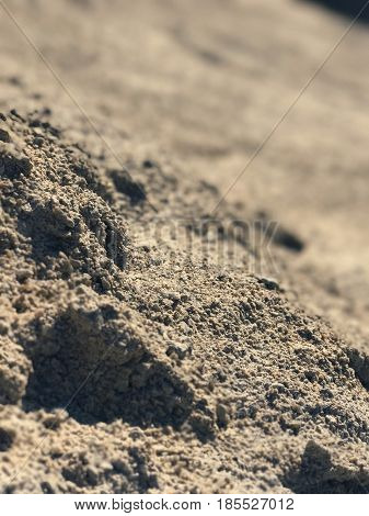 Pebble sand earth background. Dry soil with cracks