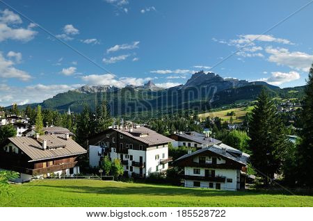 View from Cortina d Ampezzo hotels and church Gruppo Tofana or Le Tofane Gruppe alps dolomites mountains Italy there is center of Dolomities