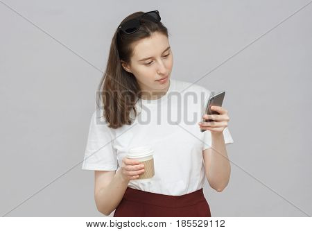Closeup Of Young Attractive Casually Dressed Caucasian Female Isolated On Gray Background With Sungl